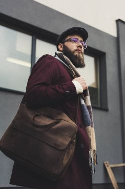 man in stylish clothing with leather bag