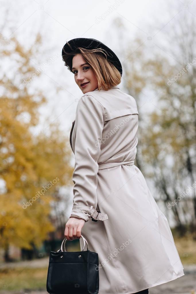 Woman walking by autumn park