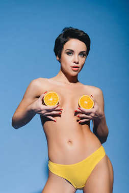 sexy girl with halved orange