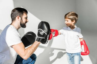 father and son boxing together