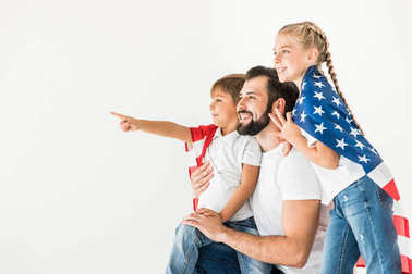 father and kids with american flag