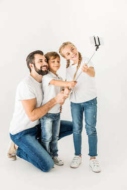 father with children taking selfie