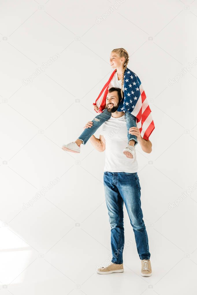 father and daughter with american flag