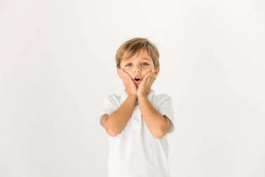 Surprised little boy looking at camera isolated on white stock vector
