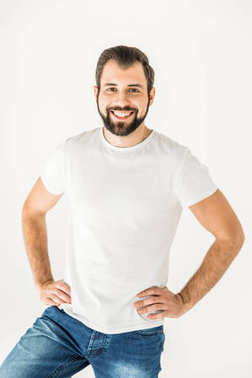 Portrait of handsome bearded young man standing with hands on waist and smiling at camera isolated on white stock vector