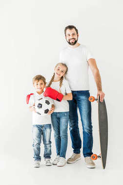 father and kids with sport equipment
