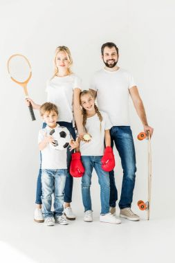 family with sport equipment