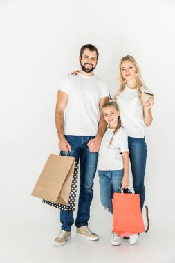 family with shopping bags and credit card