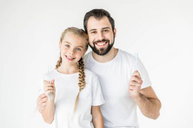 father and daughter with toothbrushes