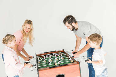 family playing foosball