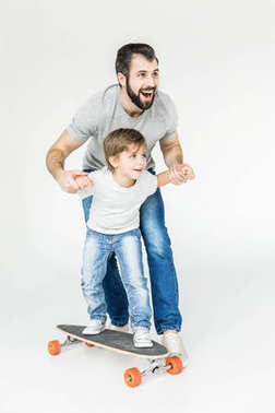 father and son with skateboard