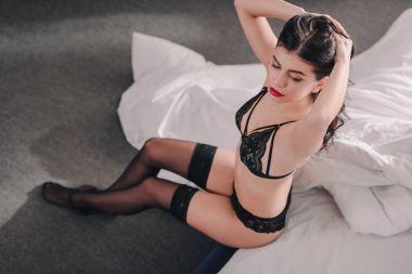 girl in black lingerie and stockings