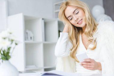 fashionable businesswoman using smartphone