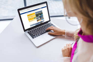 woman using laptop with booking