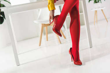 woman in red tights and heels