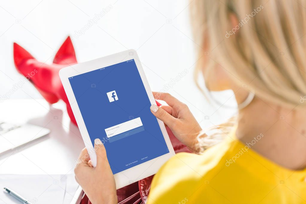 woman using tablet with facebook