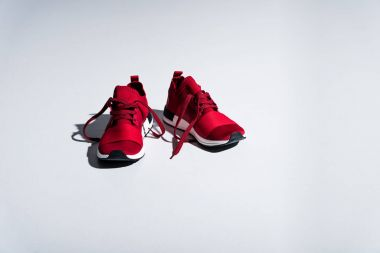 close-up view of red sneakers isolated on grey