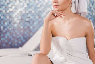 cropped shot of beautiful young woman in towel at spa