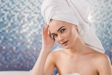 attractive young woman with towel on head at spa
