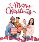 Fotografia famiglia dellafroamericano con i regali di Natale