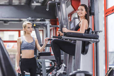 beautiful sportive women working out at gym