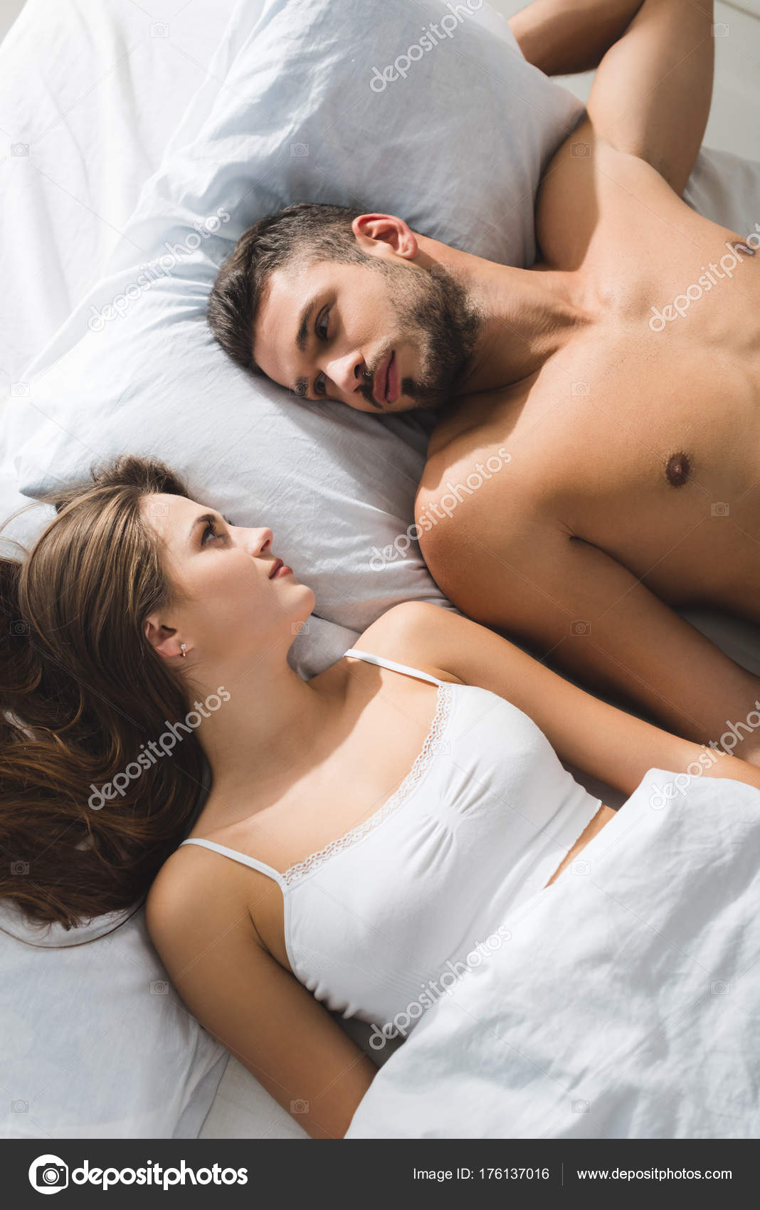 Top View Young Couple Lying Bed Looking Each Other Morning Stock Photo