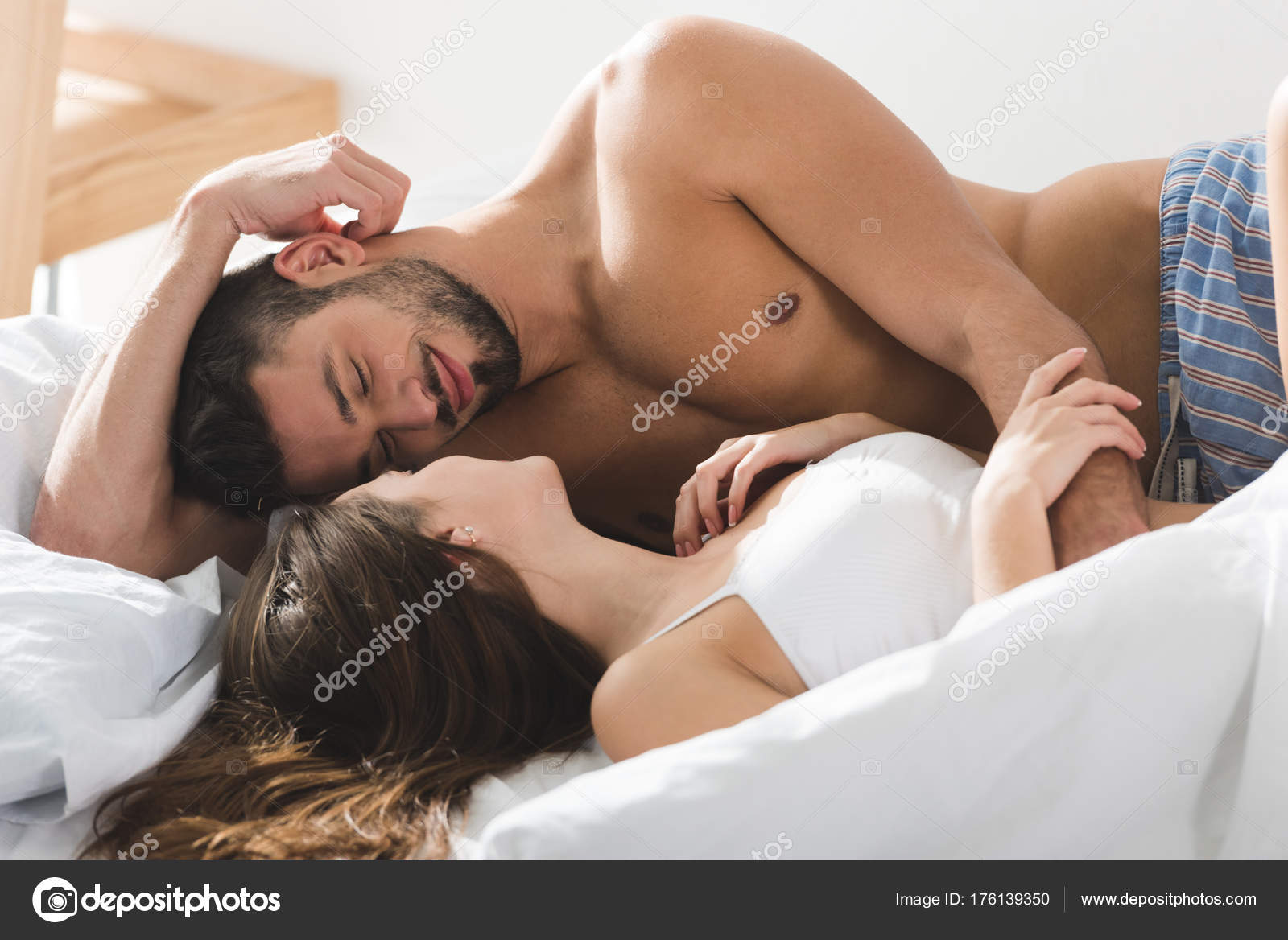 Happy Young Couple Cuddling Bed Sunny Morning Stock Photo