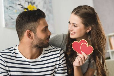 woman giving valentines day greeting card to boyfriend