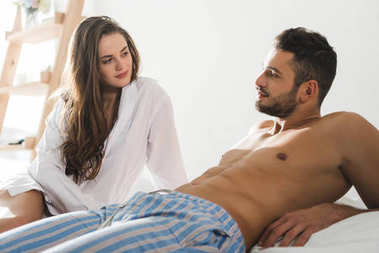 young couple spending time in bed at home