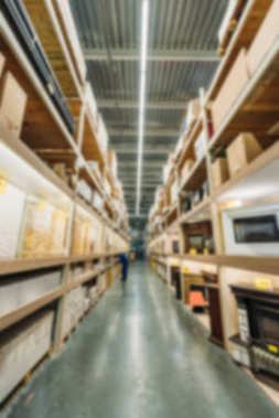 blurred view of shelves with boxes in shipping stock
