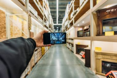 cropped view of person taking photo of storage on smartphone, Camera point of view