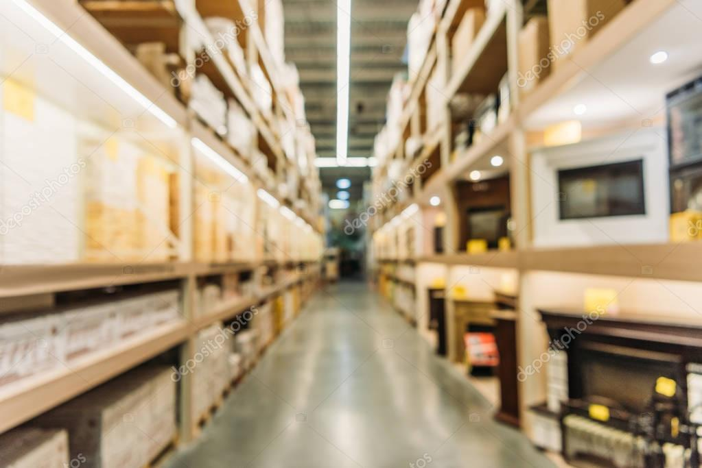 blurred view of shelves with boxes in warehouse