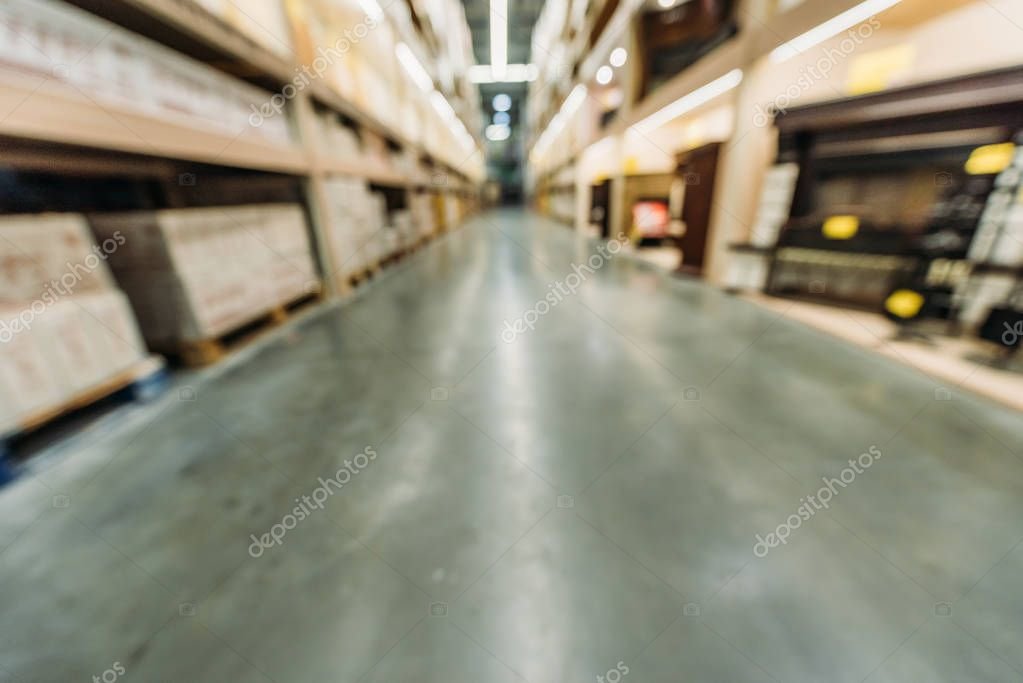 Blurred view of shelves with boxes in warehouse stock vector