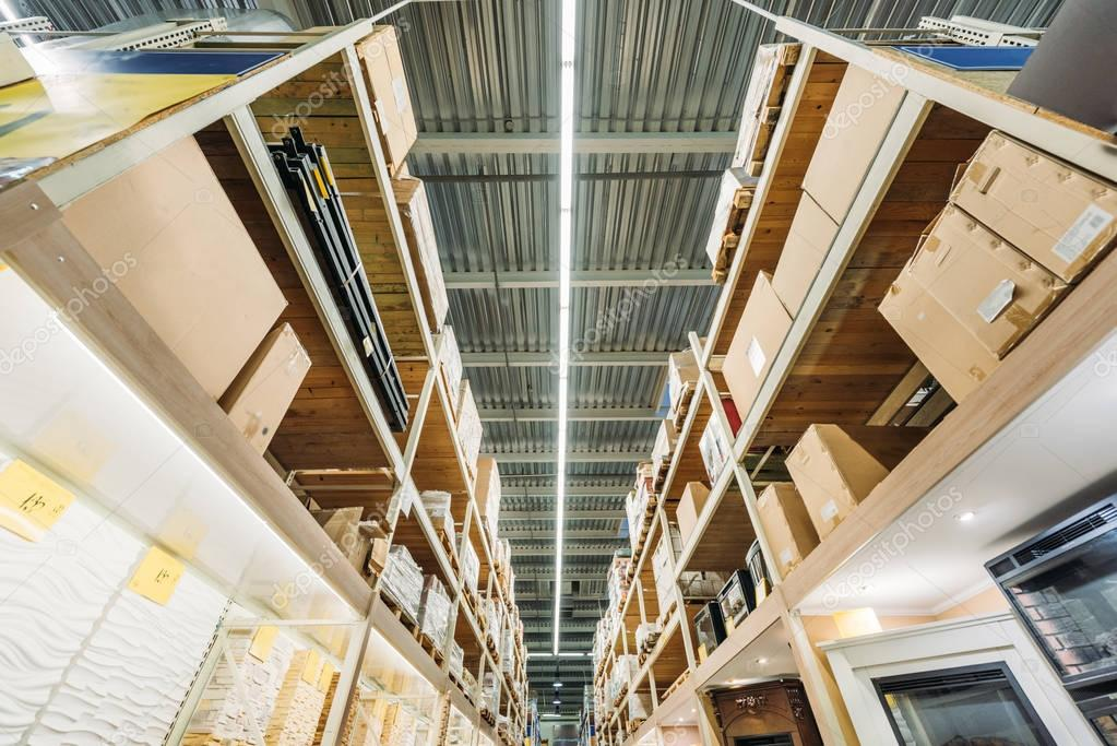 bottom view of shelves with boxes in warehouse