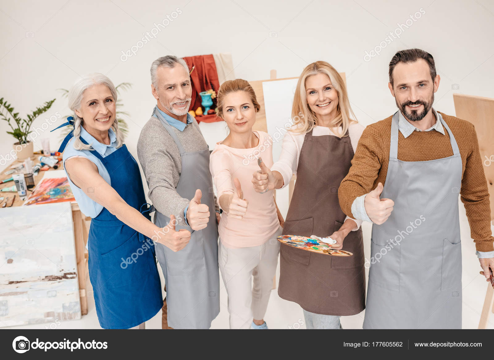 mature senior people showing thumbs smiling camera art class — stock