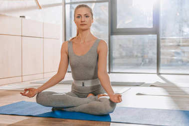 woman meditating in lotus yoga pose with mudra of knowledge