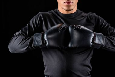 cropped shot of african american boxer in black gloves isolated on black