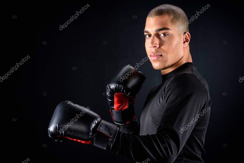 young african american boxer isolated on black
