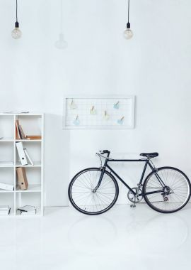 Bicycle near wooden shelves in empty office stock vector