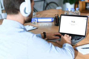 businessman using laptop with loaded google page