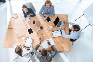 Business team working while siting at table at office space stock vector