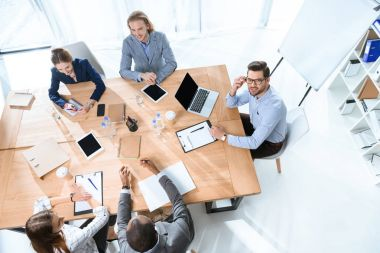 Business team sitting at table and have discussion at office space stock vector