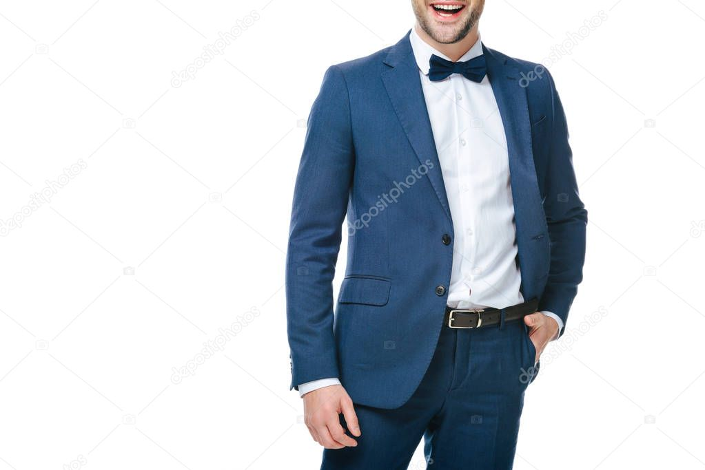 partial view of smiling man in suit isolated on white