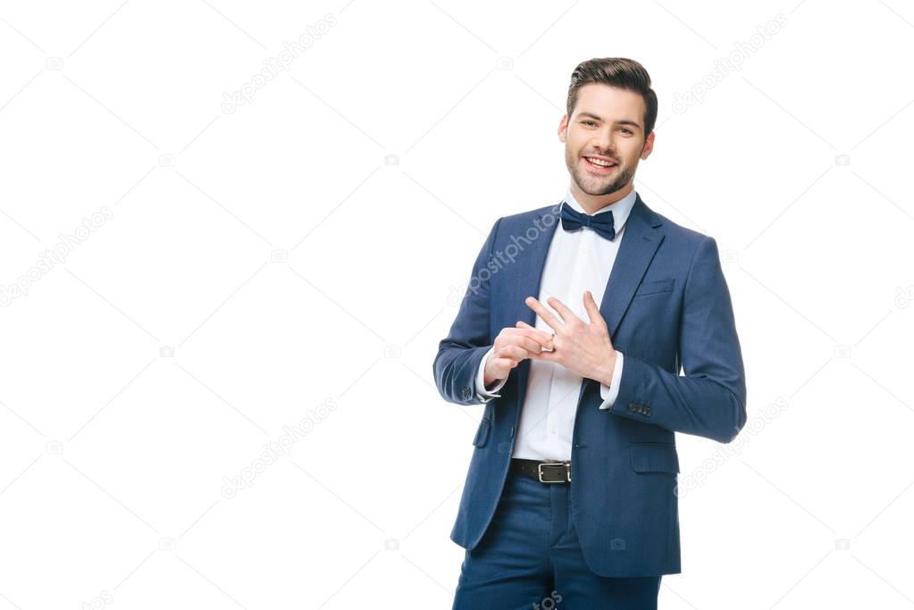 portrait of cheerful man wearing wedding ring isolated on white