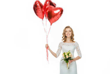 beautiful bride in wedding dress with heart shaped balloons and wedding bouquet isolated on white