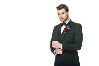 handsome young groom in suit with boutonniere isolated on white