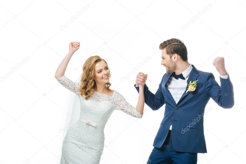 young bride and groom dancing together isolated on white