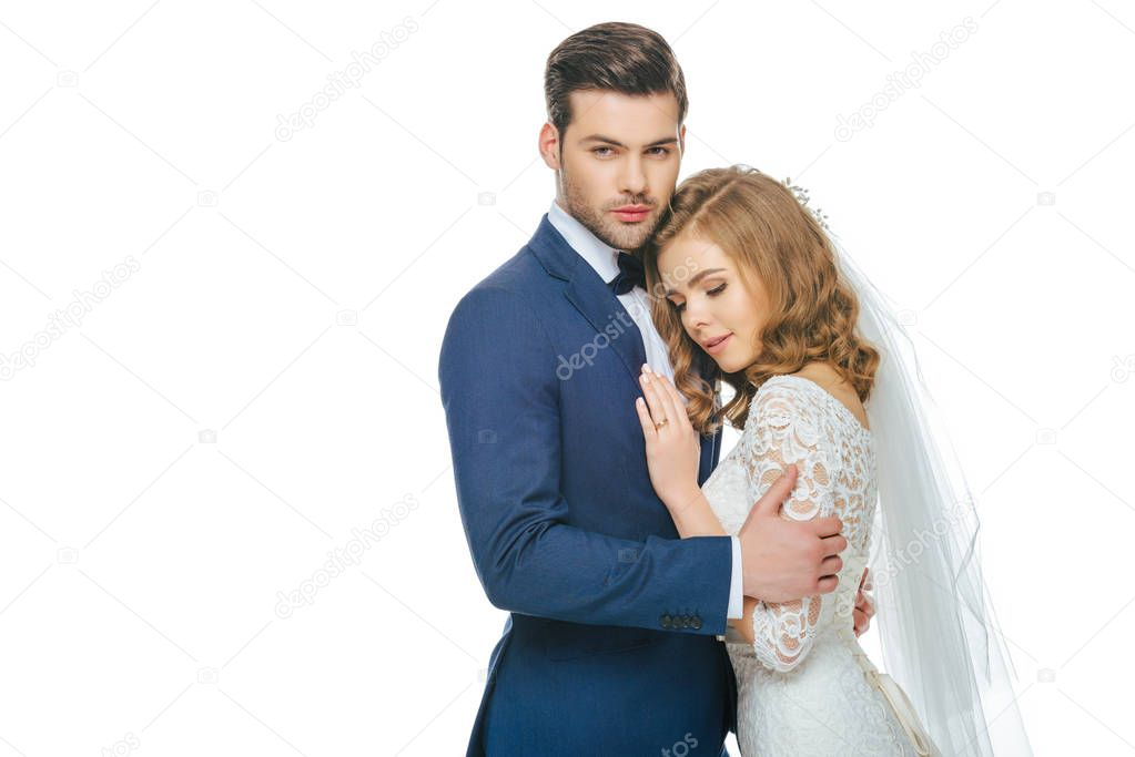portrait of sensual bride and groom isolated on white