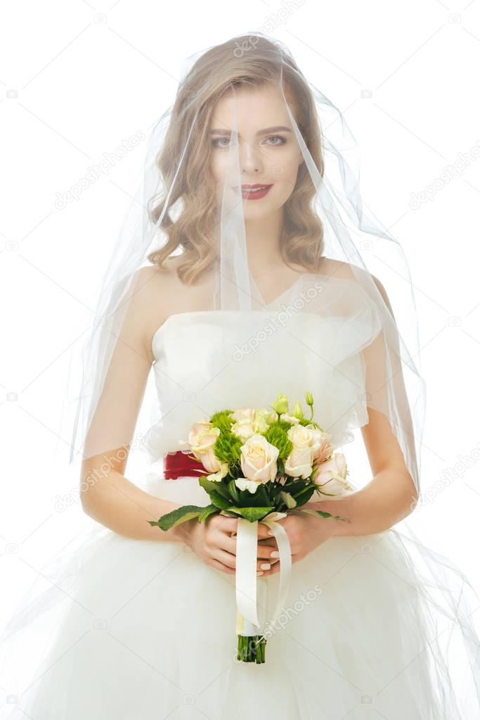 portrait of pretty bride in wedding dress and veil with wedding bouquet in hands isolated on white