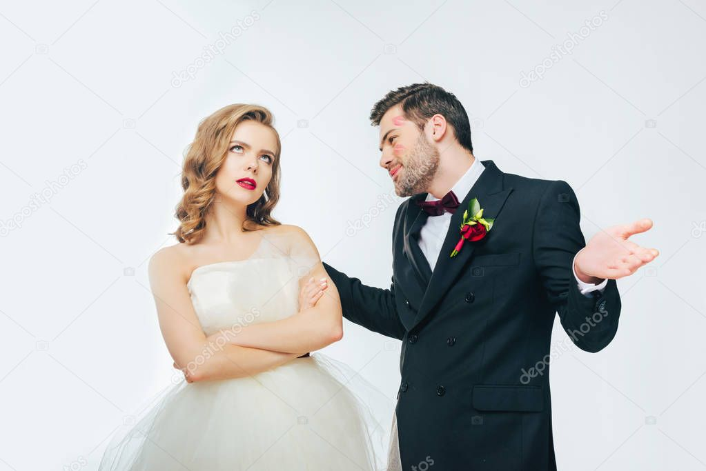 portrait of young wedding couple having argument